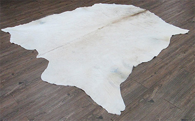exotic white cowhide rug