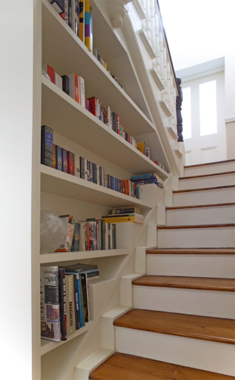 white terrace staircase bookshelf