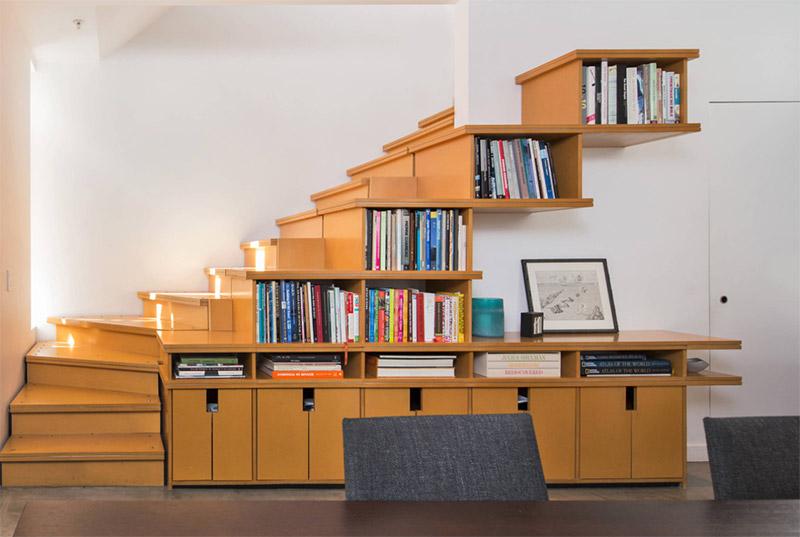 book shelving alongside staircase