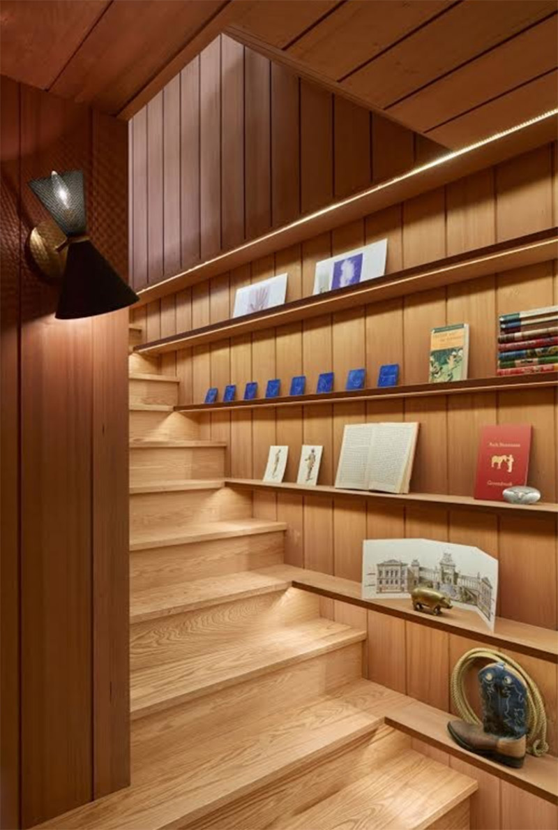 mid-century home staircase bookshelf revamp