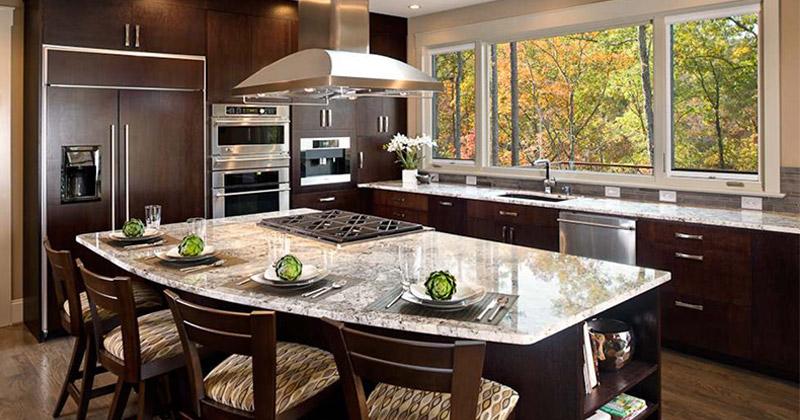 dark rounded kitchen island