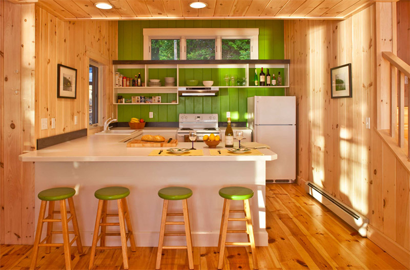 green lake house kitchen with bar stools