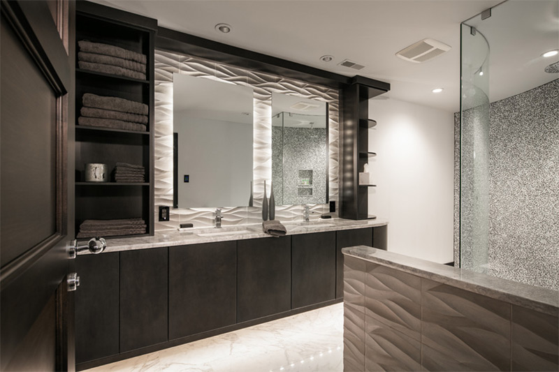 modern bathroom remodel with black cabinets