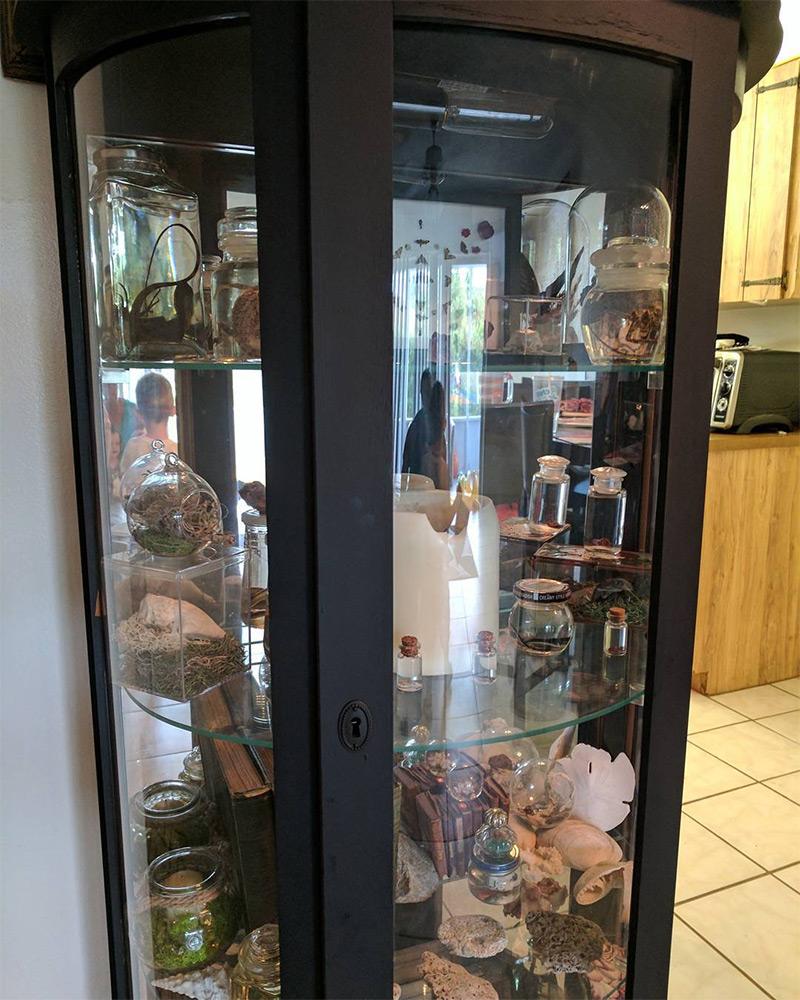 black curio cabinet with glass shelves