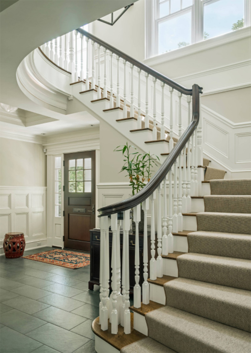 Carpeted curved staircase from Boston