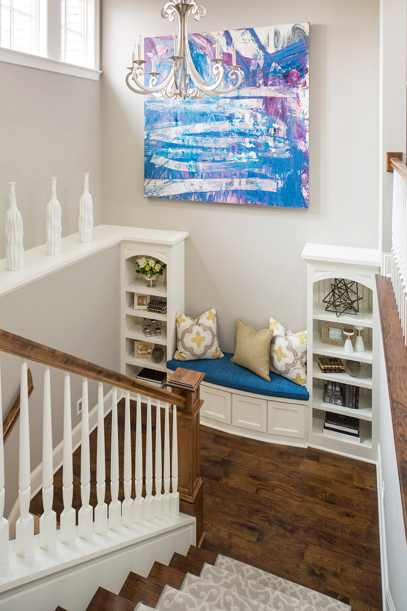 Staircase landing with seating and shelves