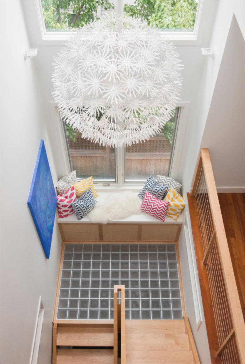 Lush seating near window staircase landing
