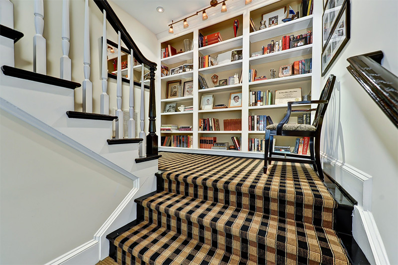 Greek renovation staircase landing with bookcases