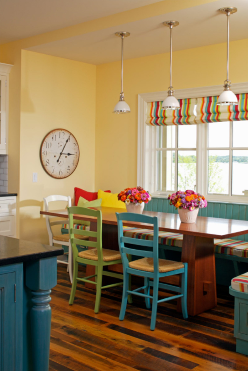 Bright yellow dining room with striped curtains