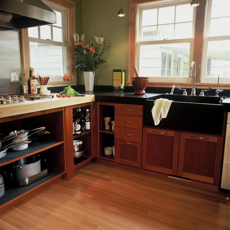 Dark countertops with black sink in kitchen