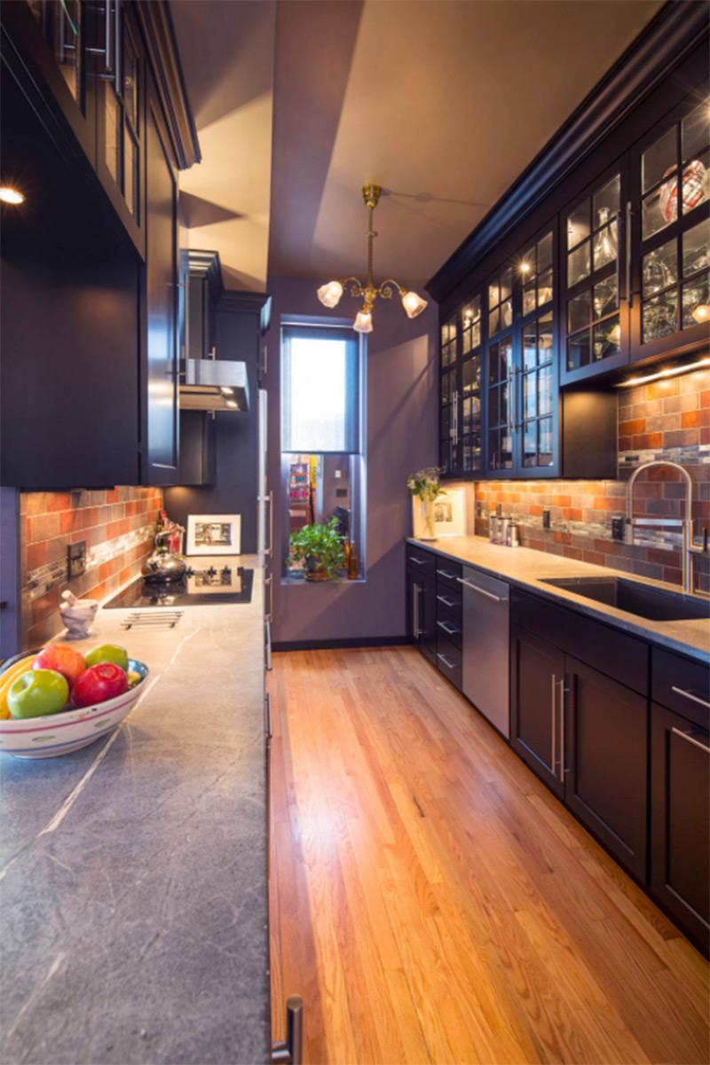 Transitional kitchen design with black sink