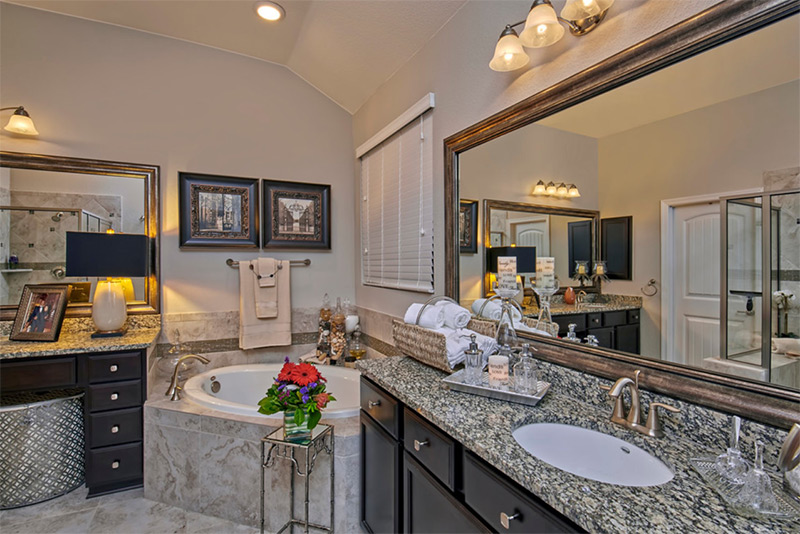 Dark bathroom cabinets with corner tub