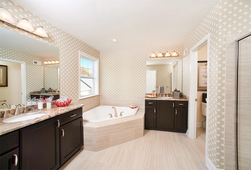 Fancy bright bathroom with corner tub