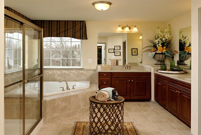 Cherry bright bathroom with corner tub