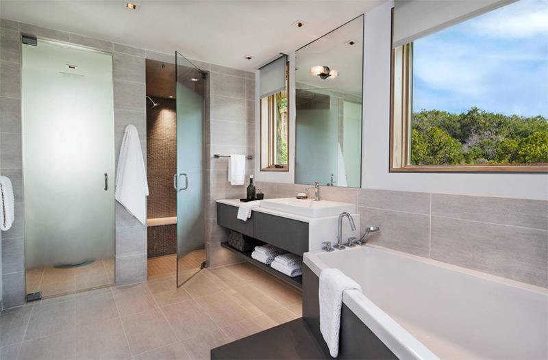 Custom modern bathroom with corner tub