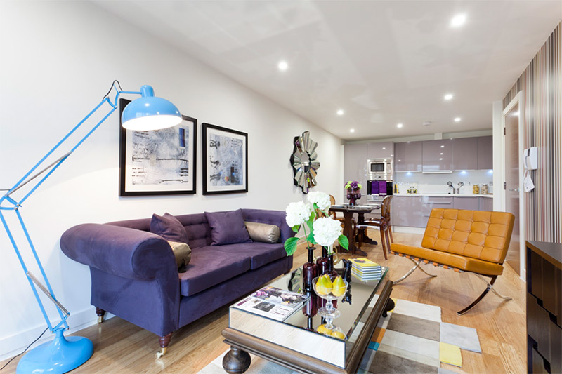Living room with eclectic purple sofa