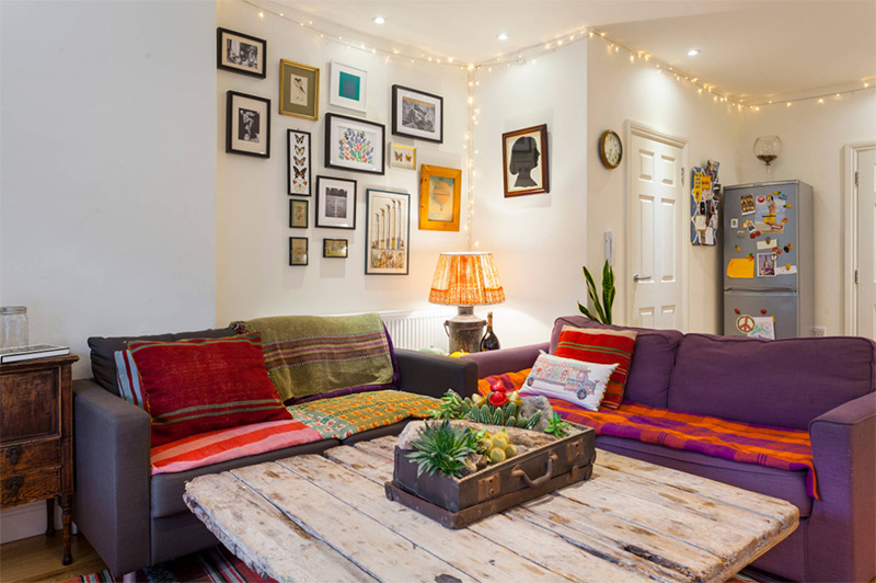 Eclectic house with purple sofas
