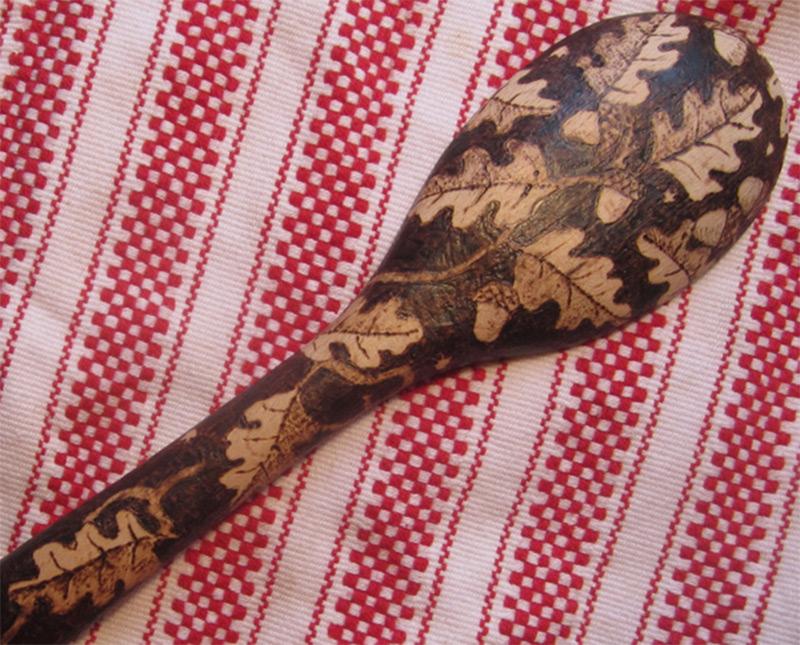 burned wooden spoon pattern leaves acorns