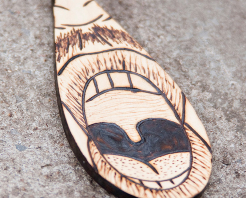 wooden spoon hipster guy mouth tasting funny